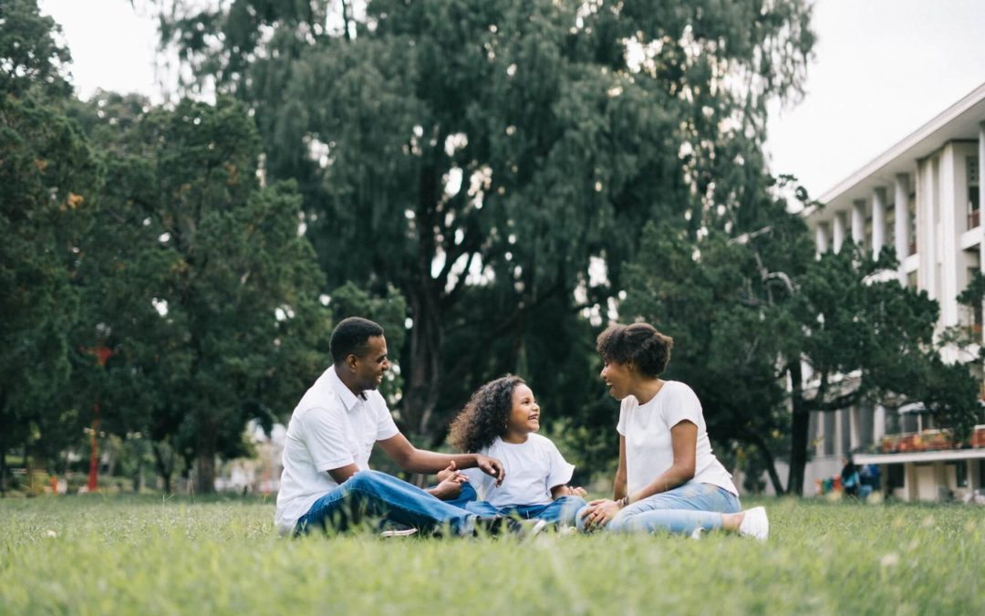 Family Sitting on Grass - Healing After Divorce Blog