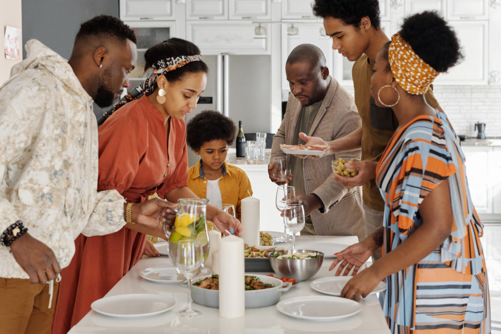 family getting ready to eat together