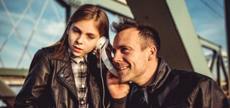 dad and daughter listening to music