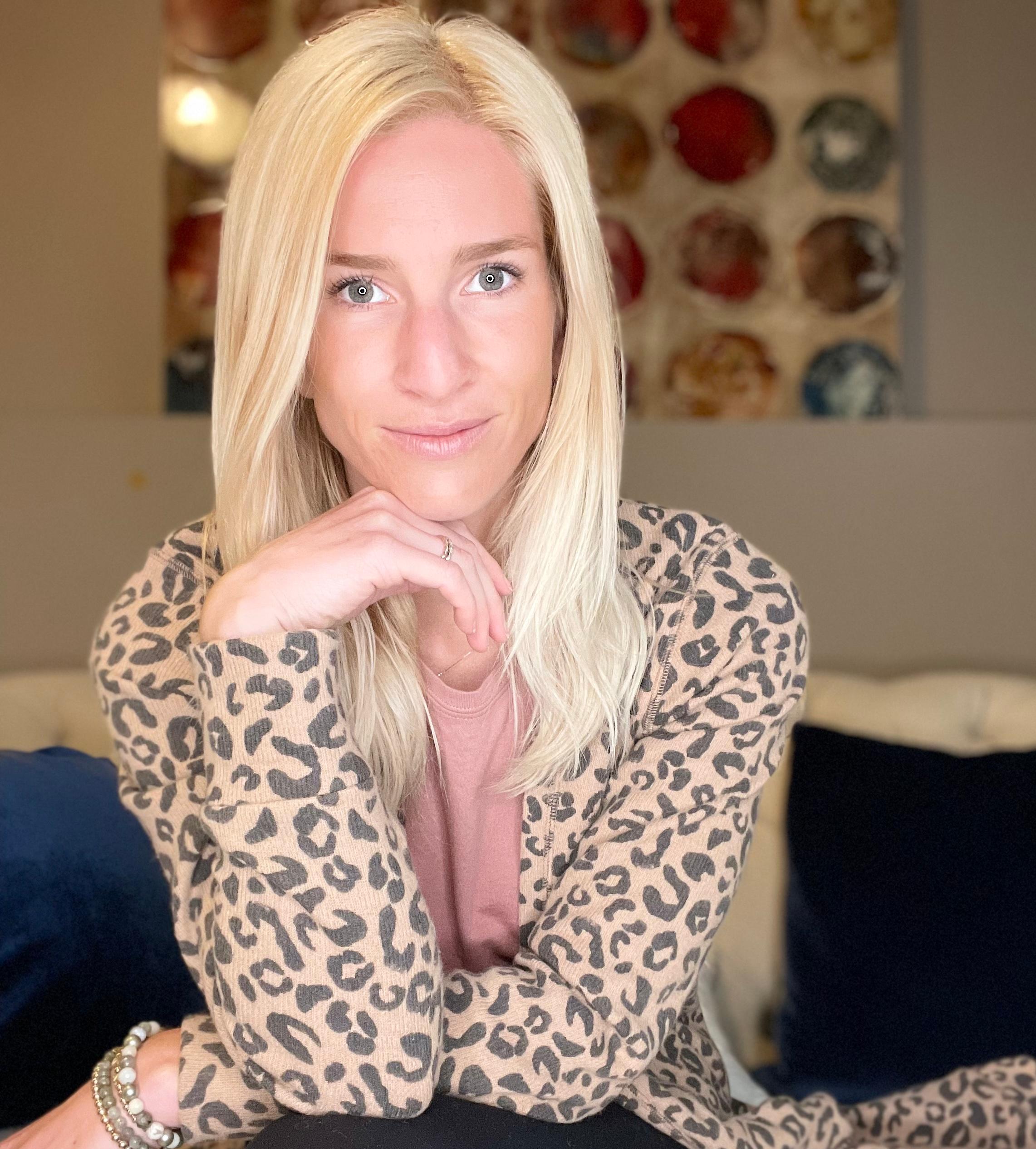 blonde woman in leopard print