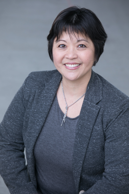 asian woman in suit
